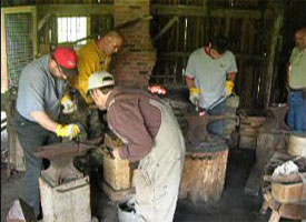 Modern-day blacksmith apprentices taking a class at Ball's Falls