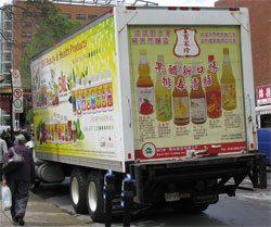A truck delivering Chinese beverages to local merchants
