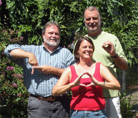 George and his siblings, Kreis (left) and Lisa, using sign language to denote their blood types