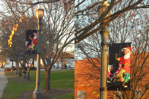 Light poles festooned with Vernon Grant Santa flags