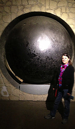 Inside the Sewer Museum--the massive wooden gravity powered sewer-cleaner ball.