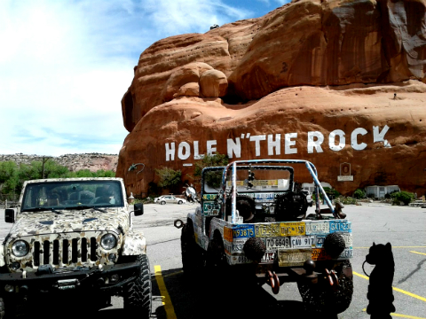 Camo Jeep and resident Jeep made from license plates, Hole in the Rock, Utah