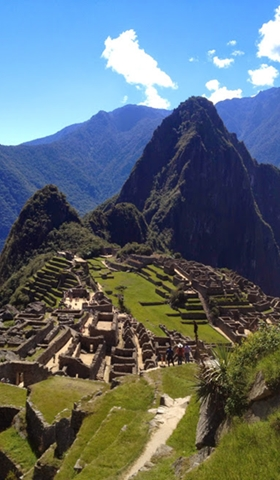 Machu Picchu ruins with the dark Huayna Picchu mountain.
