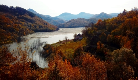 Cycling along Geamăna, the famous toxic lake, Apuseni Mountains, Romania