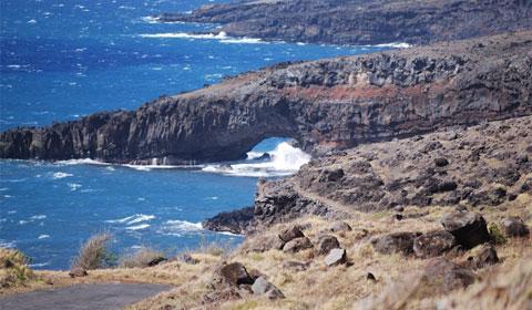 A natural volcanic rock bridge, Maui