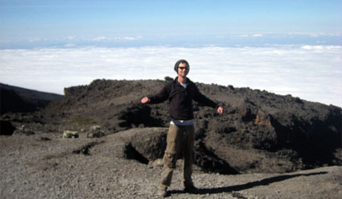 James Barnett on the summit of Mount Kilimanjaro
