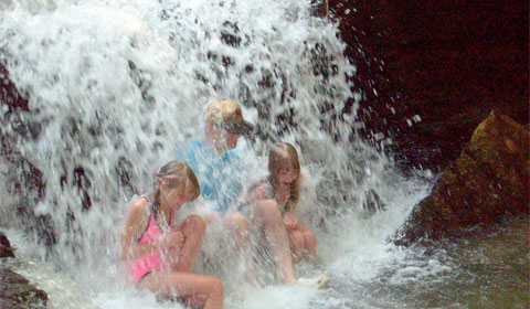 Playing in the waterfall at Brooks Falls