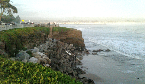 Early evening and surfers are still going into the water at Steamer Lane | Santa Cruz, California