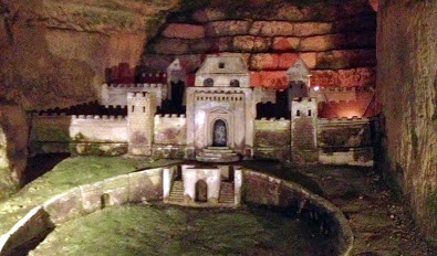 Stone carved buildings inside the catacombs.