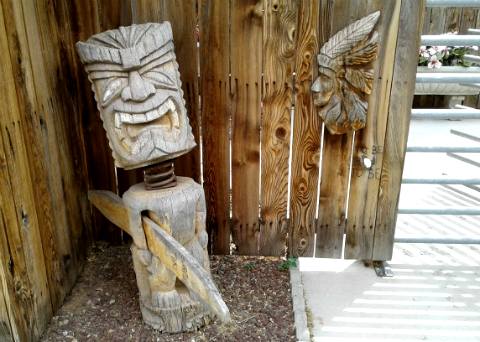 Polynesian tiki and American Indian at the entrance to the petting zoo, Hole in the Rock, Utah