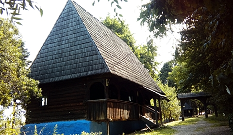 Wood carver's house with traditional blue-painted walls below the porch