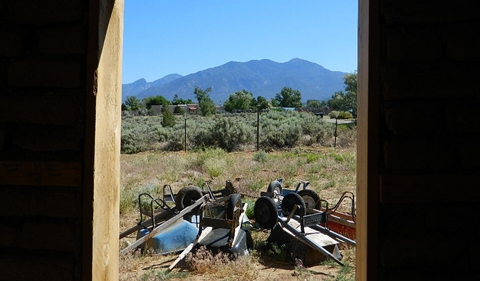 View of Taos Mountain from the master bedroom, complete with wheelbarrows