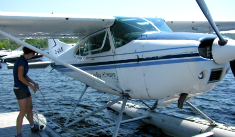 Pilot docking a float plane