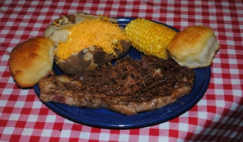 A delicious ribeye steak dinner with all the fixins'